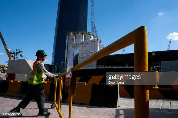 A security guard closes a gate near the under construction Exchange 106 building on the site of the Exchange TRX precinct in Kuala Lumpur Malaysia on...