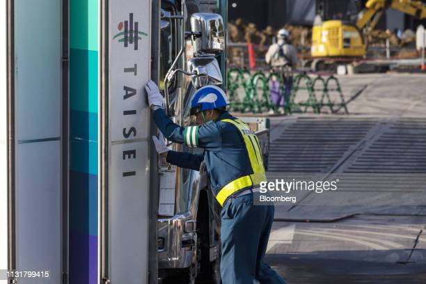 A security guard closes an entrance gate to the construction site of the New National Stadium the main venue for the Tokyo 2020 Olympic and...