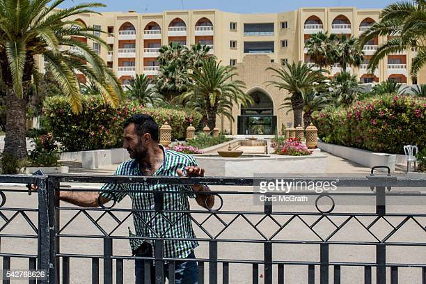 A security guard closes the front gate at the closed Imperial Marhaba Hotel on June 24 2016 in Sousse Tunisia The Imperial Marhaba hotel was the main...