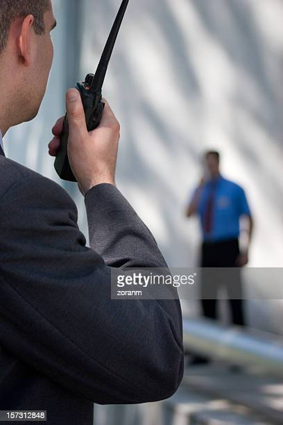 A security guard communicating with another guard