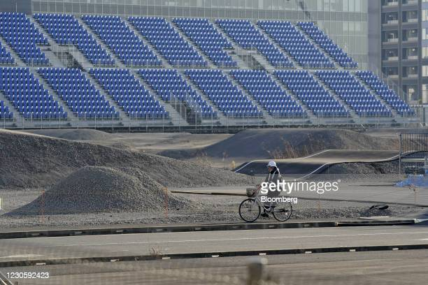Security guard cycles inside Ariake Urban Sports Park, the venue for BMX and skateboarding events at the now-postponed Tokyo 2020 Olympic Games, in...