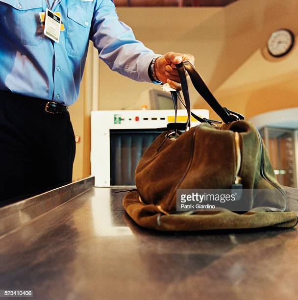 Security Guard Grabbing Bag