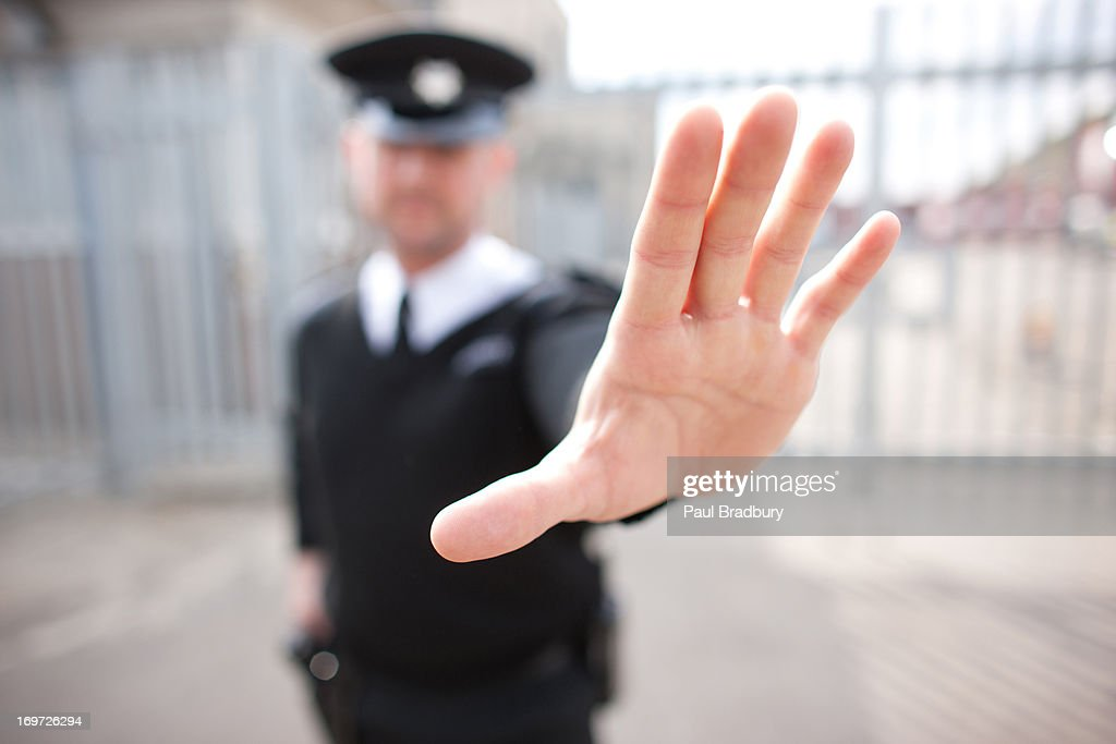 Security guard holding hand out : Stock Photo