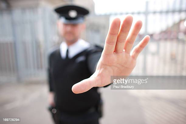 security guard holding hand out - aggression stock photos and pictures
