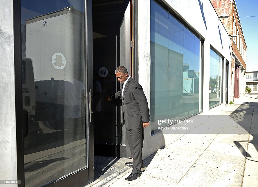 A security guard holds the door at the new headquarters of Snapchat November 14, 2013 in Venice, California. Snapchat recently turned down a $3-billion buyout offer from Facebook.