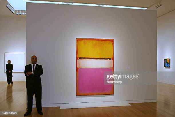Security guard Horace Wright stands beside Mark Rothko's White Center at Sotheby's on Friday May 11 2007 Philanthropist David Rockefeller Sr is...