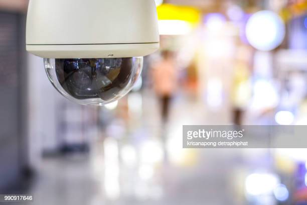 cctv security guard in the mall building. - business security camera stock pictures, royalty-free photos & images