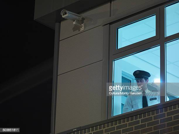 Security Guard In Window With Torch