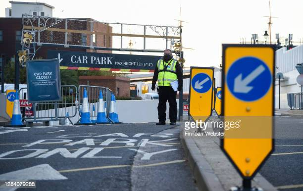 Security guard is seen at the closed Gunwharf Quays on the first day of a new national lockdown on November 05, 2020 in Portsmouth, England. England...