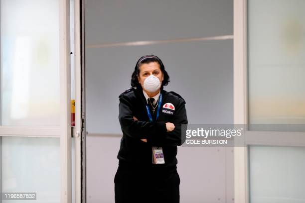Security guard is seen wearing a mask at the international arrivals area at the Toronto Pearson Airport in Toronto, Canada, January 26, 2020. -...