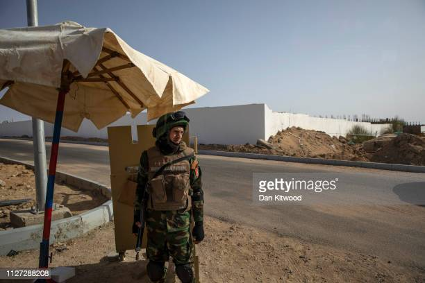 A security guard keeps watch during the first ArabEuropean Summit on February 25 2019 in Sharm El Sheikh Egypt Leaders from European and Arab nations...