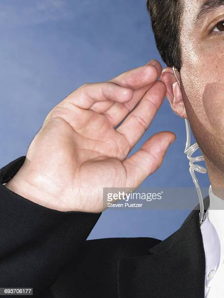 Security guard listening to earpiece