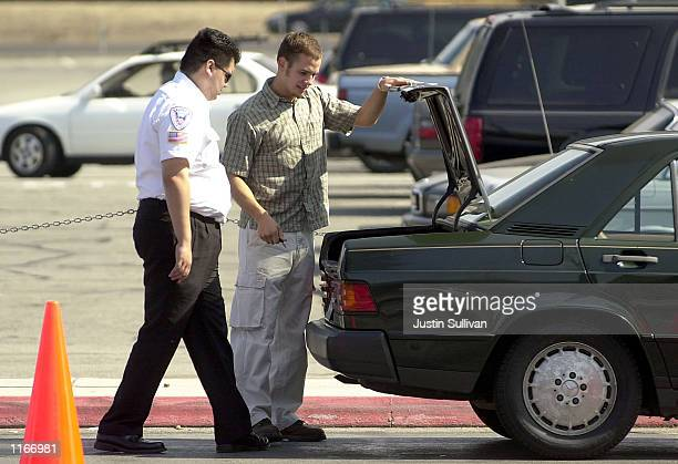 A security guard looks into the trunk of a car before allowing it to park in the short term parking September 24 2001 at San Jose International...