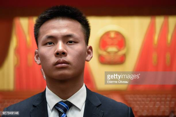 Security guard looks on after the opening session of the 13th National People's Congress at The Great Hall of People on March 5, 2018 in Beijing,...
