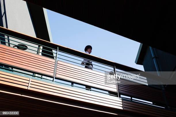 A security guard looks out over crowds from a Centre Court walkway on the opening day of the 2018 Wimbledon Championships at the All England Club in...
