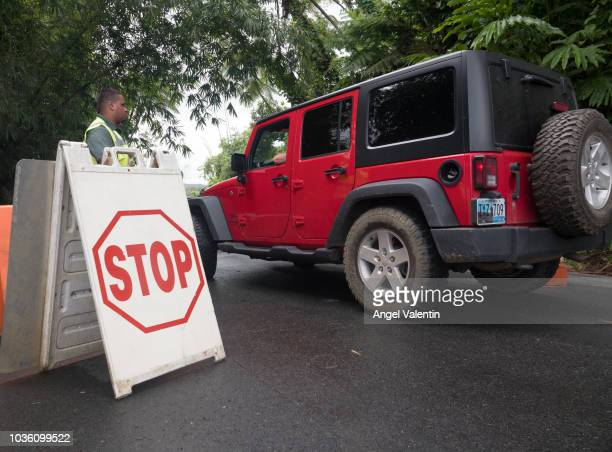 A security guard mans access to authorized personnel on the road to the top of El Yunque Rain Forest on September 19 2018 in Rio Grande Puerto Rico...