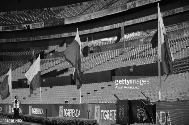 A security guard observes the empty stadium during the 10th round match between Tigres UANL and FC Juarez as part of the Torneo Clausura 2020 Liga MX...