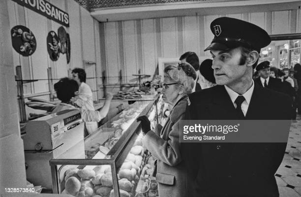 Security guard on duty in a bakery during a strike by bakery workers, UK, 9th December 1974.