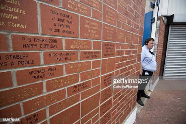 A security guard on duty next to the Centenary Wall at one of the entrances at the Victoria Ground Hartlepool before the preseason friendly between...