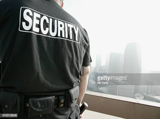 security guard on rooftop - watchmen stock pictures, royalty-free photos & images