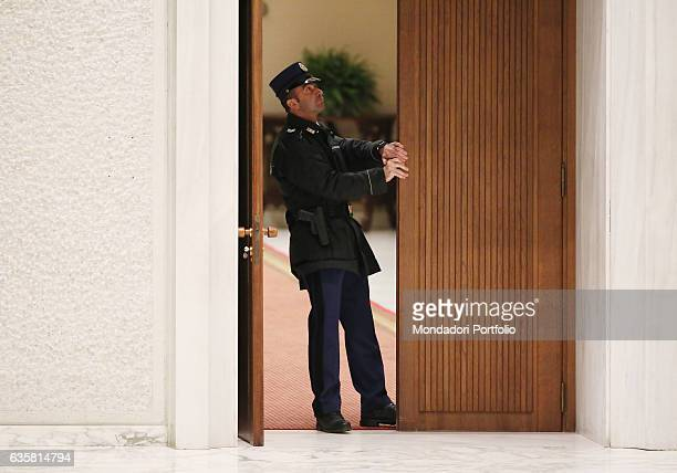 A security guard opening the door of the Paul VI Audience Hall Pope Francis is going to begin the general audience a shared moment of meditation for...