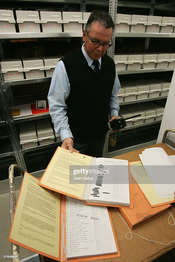 A security guard opens a sample file in the massive archives of the former Stasi, the secret police of the former East Germany January 13, 2005 in Berlin, Germany. Saturday, January 15, will mark the 15th anniversary of the storming of Stasi headquarters in Berlin by citizens in 1990, when the communist East German regime fell. The Stasi kept detailed records on millions of East Germans in a staggering volume of documents, most of which survive in today's archive. Over 90,000 people still apply evey year to see the files the Stasi kept on them.