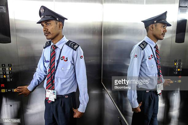 A security guard operates an elevator at the Tata Consultancy Services Ltd campus in the State Industries Promotion Corporation of Tamil Nadu Ltd IT...