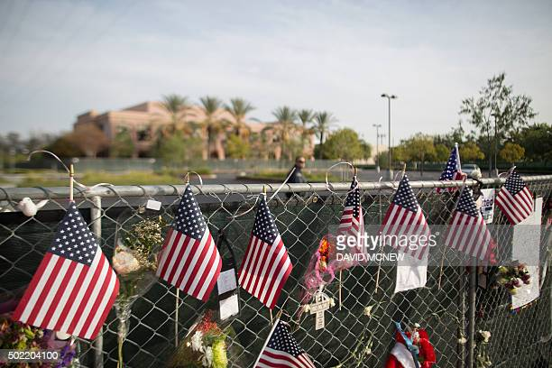 A security guard patrol sthe empty parking lot of the Inland Regional Center site of the massacre by suspects Syed Farook and Tashfeen Malik earlier...