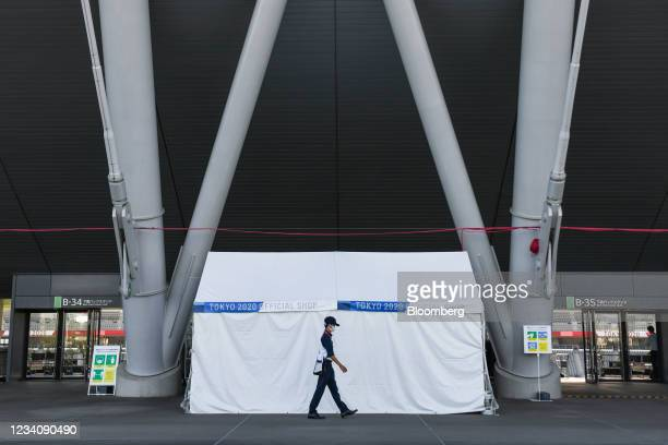 Security guard patrols by a closed souvenir kiosk at Ajinomoto Stadium, ahead of an opening round women's football match between the U.S. And Sweden,...
