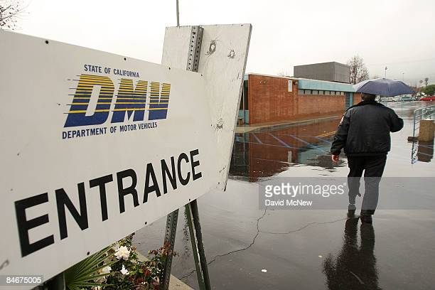 A security guard patrols the empty parking lot of the State of California Department of Motor Vehicles February 6 2009 in Pasadena California The DMV...