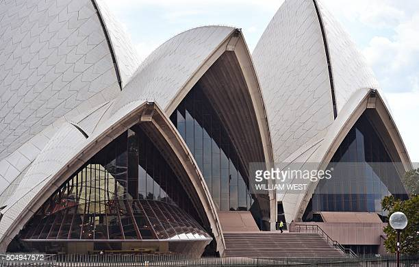 A security guard patrols the normally crowded steps of the Sydney Opera House deserted after a security scare sparked by 'information on social...