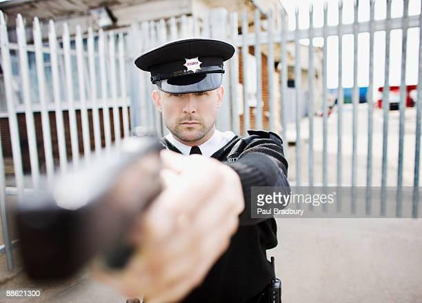 Security guard point gun