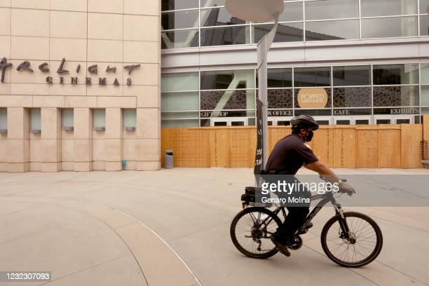 Security guard rides past the shuttered Archlight Cinemas in Hollywood on April 13, 2021. ArcLight Cinemas and Pacific Theaters said late Monday they...