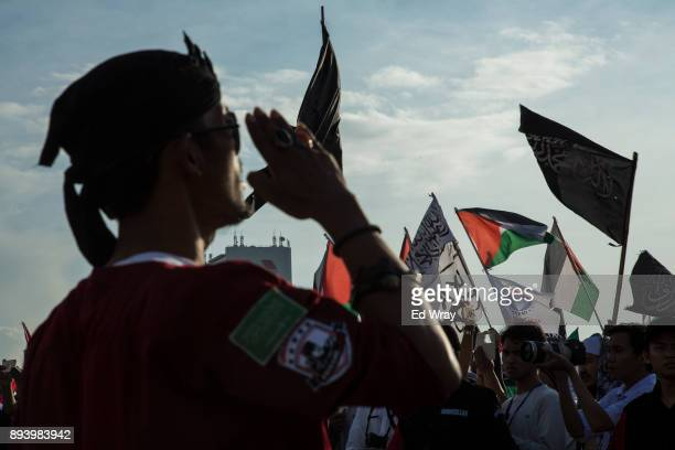 Security guard salutes at the start of a large demonstration against the United States' decision to recognize Jerusalem as the Capital of Israel on...