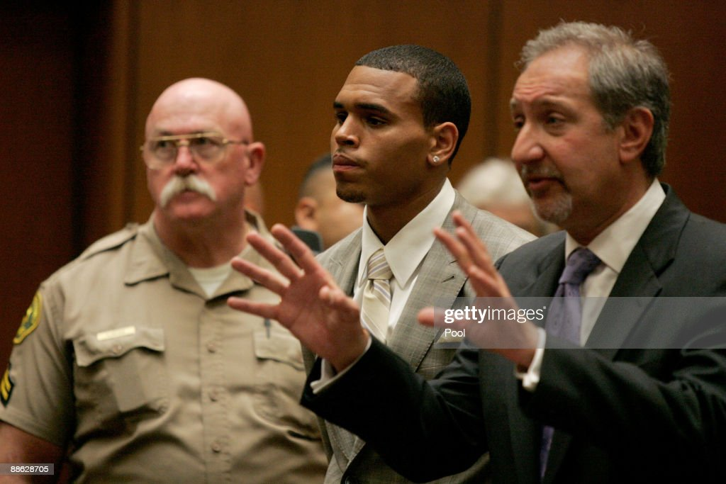 Security guard, singer Chris Brown and attorney Mark Geragos at a preliminary hearing at Superior Court of Los Angeles County on June 23, 2009 in Los Angeles, California. The preliminary hearing is to determine if Chris Brown will stand trial for allegedly attacking pop singer Rihanna, during an argument in a rented Lamborghini sports car following a pre-Grammy Awards party on February 8, 2009. He is currently free on $50,000 bail.