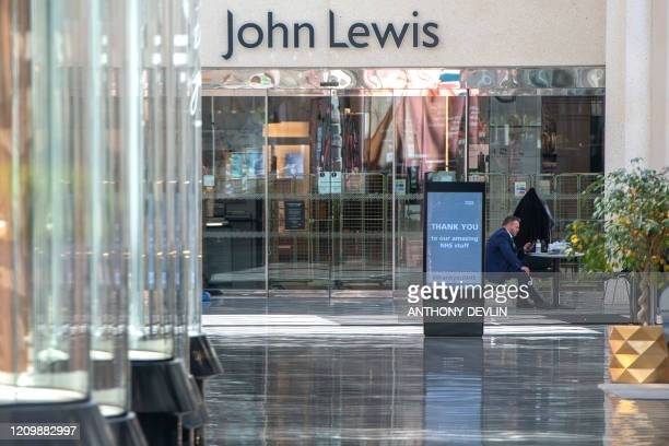 Security guard sits at a desk in an empty shopping centre in Leeds city centre, West Yorkshire on April 14 as life in Britain continues during the...