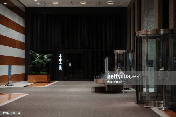 Security guard sits at a desk in the empty lobby of the TD Canada Trust Tower on Bay Street in Toronto, Ontario, Canada, on Thursday, March 25, 2021....