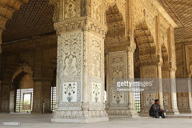 A security guard sits inside the Red Fort in Old Delhi ahead of the Delhi 2010 Commonwealth Games on September 30 2010 in Delhi India