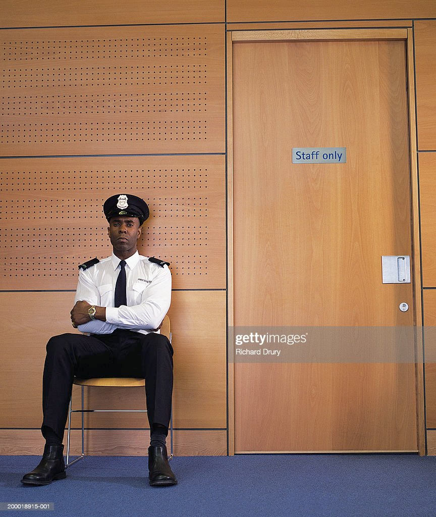 Security guard sitting by office door stock photo getty images - Security guard hd images ...