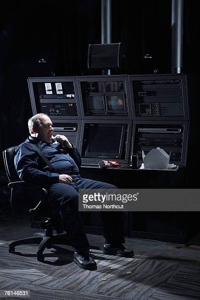 Security guard sitting in office