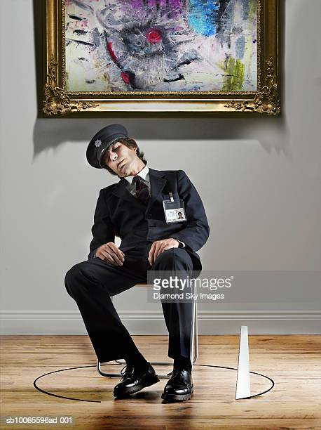 security guard sleeping in chair, saw cutting wooden floor around it - guarding stock pictures, royalty-free photos & images