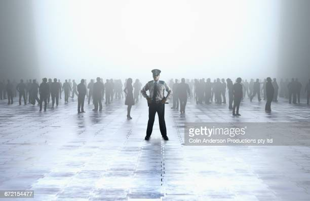 Security guard standing in front of crowd