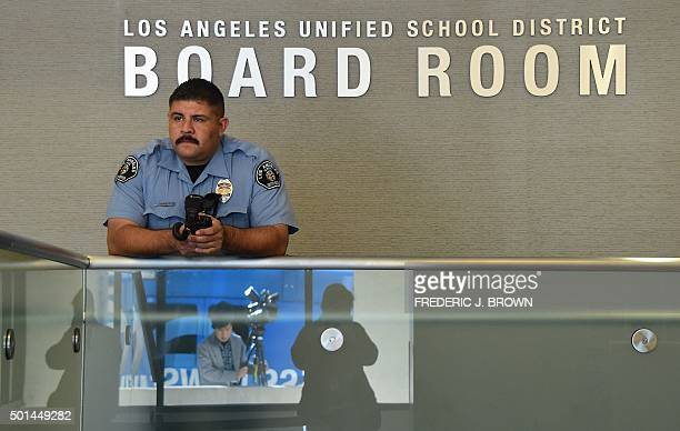 Security guard stands at the administrative offices of the Los Angeles Unified School District where schools superintendant Ramon Cortines, Mayor...