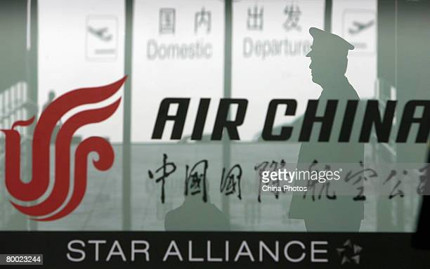 A security guard stands at the counter of Air China in the new terminal building T3 at the Beijing Capital International Airport on February 26 2008...