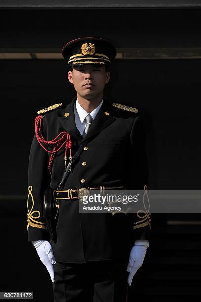 A security guard stands at the entrance of the Imperial palace as thousands of people visit the Imperial Palace which was opened for the New Year's...