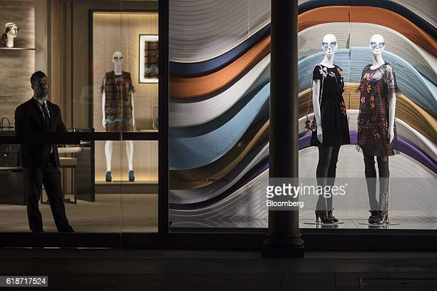 A security guard stands at the entrance to a Fendi SpA luxury goods store on New Bond Street in London UK on Thursday Oct 27 2016 Multiple reports...
