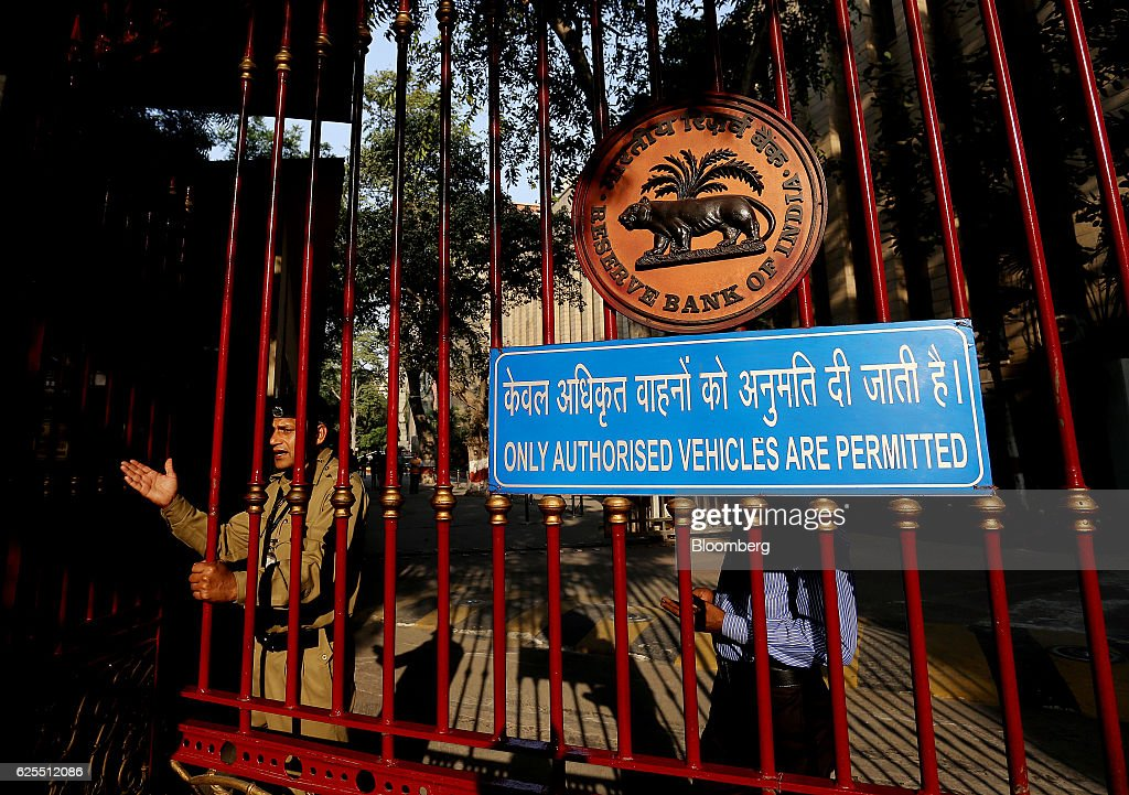 Indian Rupee and RBI Headquarters As Currency Falls To Record Low : News Photo