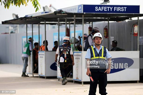 A security guard stands at the Samsung Electronics Vietnam Co Plant at Yen Phong Industrial Park in Bac Ninh Province Vietnam on Thursday Sept 1 2016...