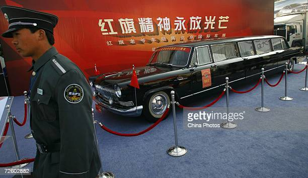 A security guard stands beside a 1008 meter long Red Flag car at the 2006 International Automotive Exhibition November 18 2006 in Beijing China The...