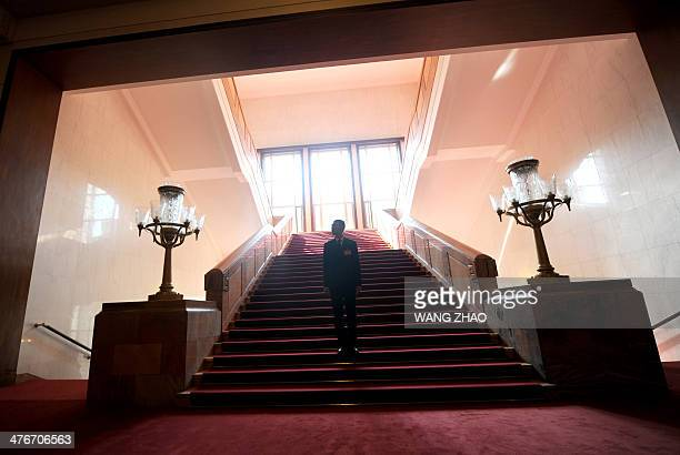 A security guard stands during the opening session of the 12th National People's Congress at the Great Hall of the People in Beijing on March 5 2014...